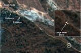 Figure 4 is DigitalGlobe Imagery from April 19th, 2014 and clearly shows a Large Trailer Truck Seen Leaving the South Portal Area of North Koreas Punggye-ri Nuclear Test Site.