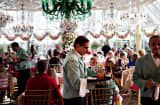 Waiter carries customer orders in the Crystal Dining Room at Tavern On The Green in New York, Dec. 30, 2009.