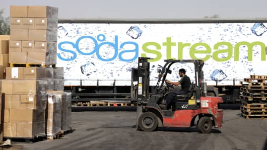 An employee uses a forklift truck to prepare pallets of SodaStream products for export at the SodaStream International Ltd. factory in Mishor Adumim, near Jerusalem, Israel.