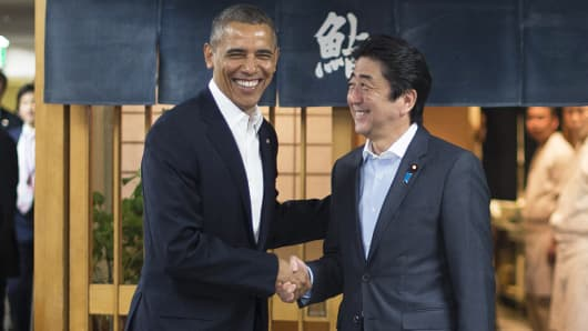 President Barack Obama shakes hands with Japanese Prime Minister Shinzo Abe before a private dinner at Sukiyabashi Jiro restaurant in Tokyo on April 23, 2014.