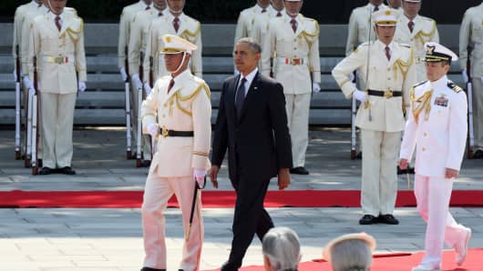 President Obama inspects an honor guard as Japan's Emperor Akihito and Empress Michiko, bottom, look on during a welcoming ceremony at the Imperial Palace in Tokyo.