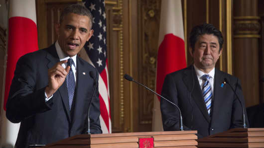 US President Barack Obama speaks as Japanese Prime Minister Shinzo Abe looks on during a bilateral press conference in Tokyo on Thursday.
