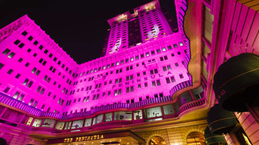The illuminated exterior of The Peninsula Hong Kong in Tsim Sha Tsui, opened in 1928 and expanded in 1994 it is the flagship property of the The Peninsula Hotels group.