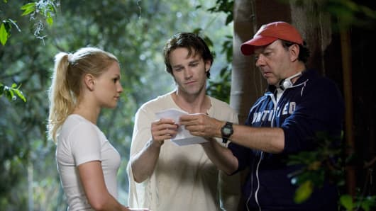 "In this image released by HBO, actors Anna Paquin, left, Stephen Moyer, center, and creator Alan Ball are shown on the set of the HBO original series, ""True Blood."""