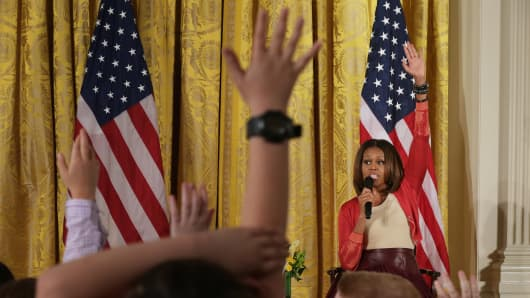 First lady Michelle Obama takes questions from Executive Office employees' children during an event to mark the White House's annual Take Our Daughters and Sons to Work Day at the White House on April 24, 2014 in Washington, DC.