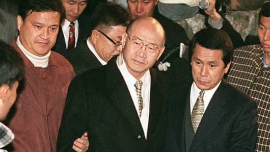 Former South Korean President Chun Doo-Hwan(C) is arrested by prosecution authorities at a relative's house in Hapchon, on December 3rd, 1995.