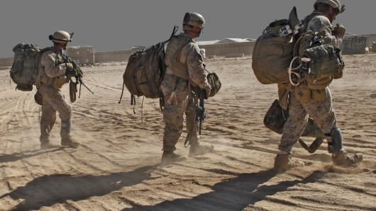 In this photo taken Monday, Oct. 12, 2009, U.S. Marines with Alpha Company- Task Force Raider, 2nd Recon Battalion, arrive at a forward operating base en route to a mission, in Helmand province, southern Afghanistan, Monday, Oct. 12, 2009. Task Force Raider are a strike force whose purpose is to conduct raids targeting Taliban networks in the Helmand province. (AP Photo/Brennan Linsley)