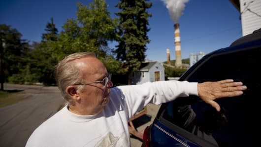 Kerry VanKirk, 68, laments about the amount of fly ash that comes from the exhaust stack of the Mitchell Power Station, a coal-fired power plant built along the Monongahela River, 20 miles southwest of Pittsburgh, on Sept. 24, 2013, in New Eagle, Pa.