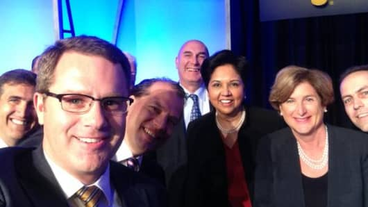 CEO selfie L-R: John Bryant, CEO, Kellogg Company; Doug McMillon, CEO, Walmart blocks face of  AG Lafley, COB, President and CEO, Procter & Gamble; Kees Kruythoff, President, North America, Unilever; Hugh Grant, Chairman and CEO, Monsanto; Indra Nooyi, Chairperson and CEO, PepsiCo; Denise Morrison, President and CEO, Campbell; Roberto Marques, Chairman, Consumer NA, J&J.