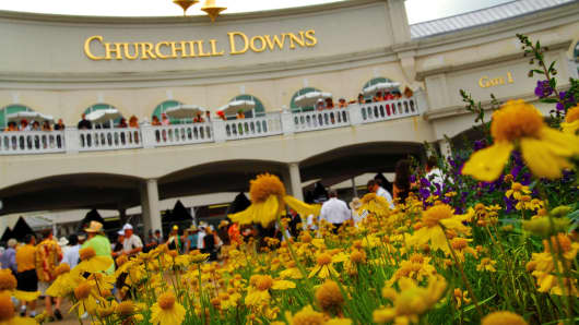 Fans gather at the entrance of the Kentucky Derby at Churchill Downs in Louisville, Kentucky.