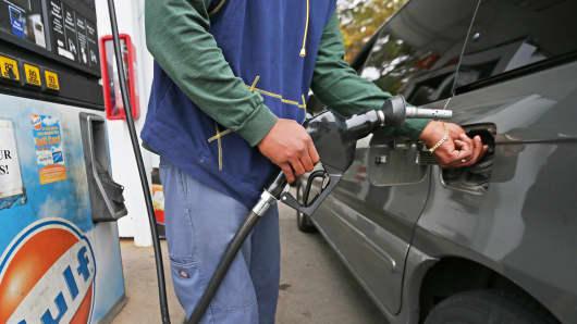 Man pumps gas in Weymouth, Mass.