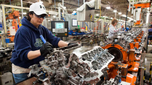An employee works on the assembly line installing parts on the Duratech 35 V6 engine at the Ford Motor Co. Engine Plant in Lima, Ohio, U.S. on Friday, March 28, 2014.