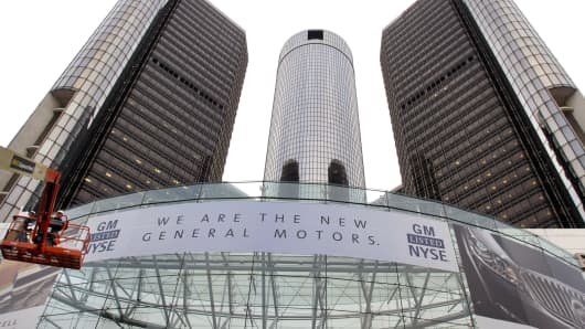 The front of the General Motors world headquarters complex sports a new banner to proclaim its return to the NYSE November 18, 2010 in Detroit, Michigan.