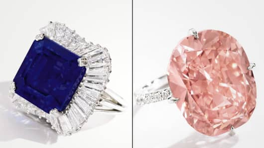Sotheby's in New York City auctioned off a total of $44.3 million dollars in sales at its Magnificent Jewels auction. The big record breaker was a stunning 28.18 carat sapphire and diamond ring selling for $5 million dollars (L). The top seller of the evening was a 15 carat orangy pink diamond and diamond ring that sold for $6.1 million dollars.