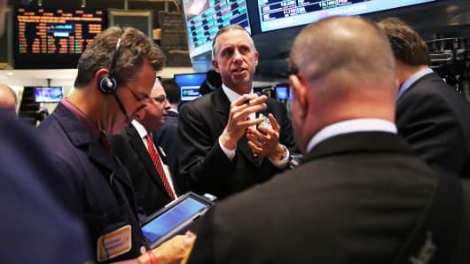 Traders work on the floor of the New York Stock Exchange on April 30, 2014.