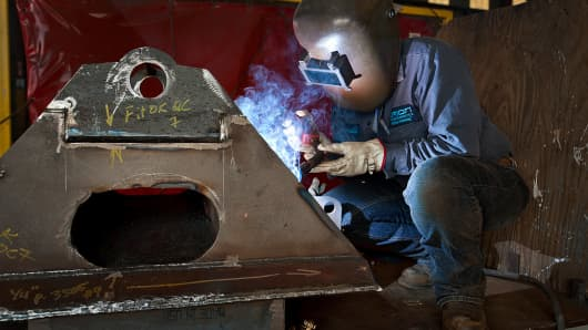 A welder works on a fifth wheel for a new oil and gas drilling rig at the Orion Drilling Co. manufacturing and fabrication facility in Corpus Christi, Texas