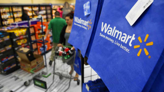 Walmart customers push carts past reusable shopping bags in Los Angeles.