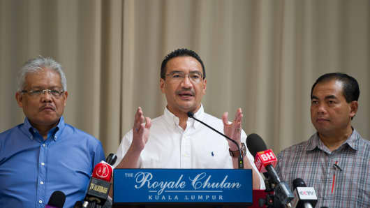 Malaysian Minister of Defence and Acting Transport Minister Hishammuddin Hussein (C) speaks during a press conference at a hotel in Kuala Lumpur.