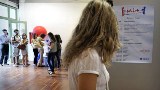 Young graduates visit a job fair at the Athens Technopolis