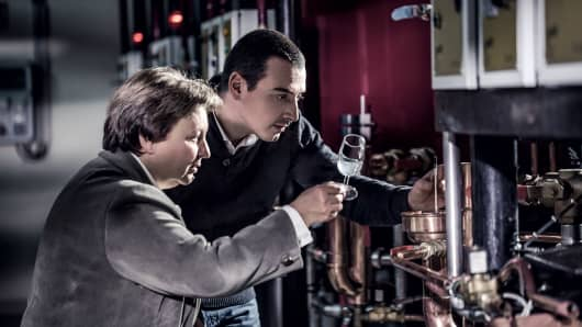 Distillers analyze cognac at Remy Martin.