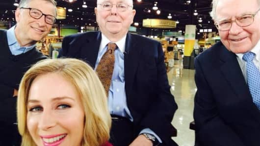 "Bill Gates, Charlie Munger and Warren Buffett participate in a ""selfie"" taken by CNBC's Becky Quick in Omaha. In a live interview, Buffett said based on his experiences with college students who visit Omaha, selfies are ""all the rage."" The estimated net worth of the three men in the picture: $143.1 billion."