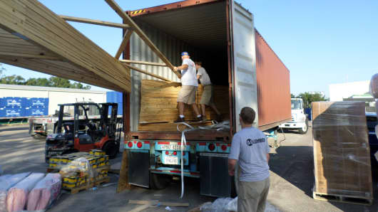 In Summerville, S.C., 84 Lumber workers load a container of US-manufactured building materials bound for Mongolia.
