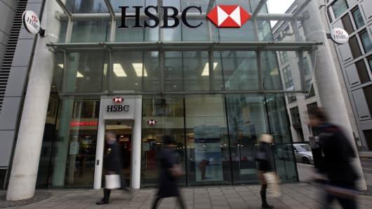 Pedestrians pass a HSBC bank branch in London, U.K.