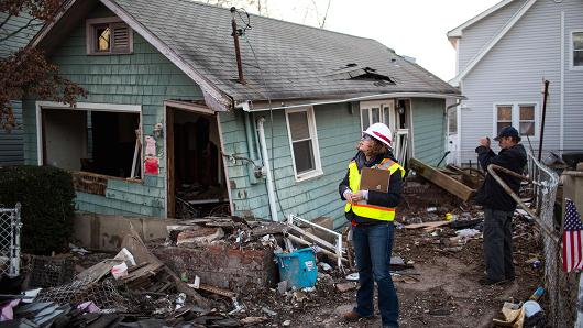 Federal inspectors check a home destroyed by Hurricane Sandy on Staten Island, N.Y., Nov. 28, 2012.