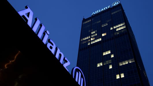 The logo of German insurer Allianz stands on the company's office buildings at Treptowers in Berlin, Germany.