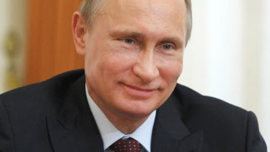Russia's President Vladimir Putin smiles in the Novo-Ogaryovo residence outside Moscow, on April 18, 2014.
