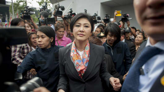 Thai Prime Minister Yingluck Shinawatra meets her supporters after the Thai Constitutional Court ruled that she and 9 cabinet ministers are to step down.