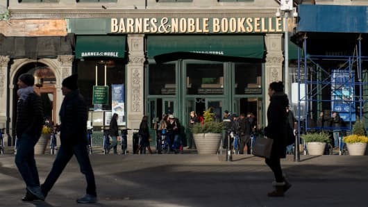 Pedestrians pass in front of a Barnes and Noble Inc. store in New York.