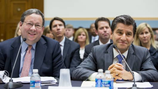 David L. Cohen, executive vice president of Comcast, and Robert D. Marcus, chairman and CEO of Time Warner Cable, testify during a House Judiciary Committee hearing on the proposed merger of Time Warner Cable and Comcast, on Capitol Hill, May 8, 2014 in Washington, DC