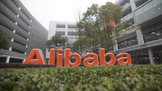 Signage is displayed outside Alibaba.com Ltd.'s headquarters in Hangzhou, China.