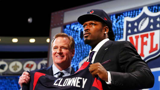 Jadeveon Clowney of the South Carolina Gamecocks with NFL Commissioner Roger Goodell after he was picked #1 overall by the Houston Texans during the first round of the 2014 NFL Draft, May 8, 2014 in New York City.