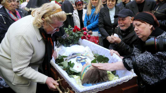 Relatives and mourners of 18-year old Vadim Papura, a pro-Russian activist killed after he jumped off from the Odessa Trade Union building on May 2, 2014, attend his funeral four days later.