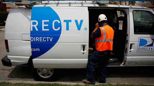 A DirecTV technician at an apartment building in Lynwood, Calif.