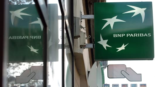 A sign with the BNP Paribas logo hangs above one of the bank's branches in Paris, France.