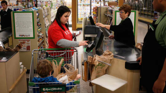 A customer pays for her purchases at a Publix Super Markets grocery store in Knoxville, Tennessee.