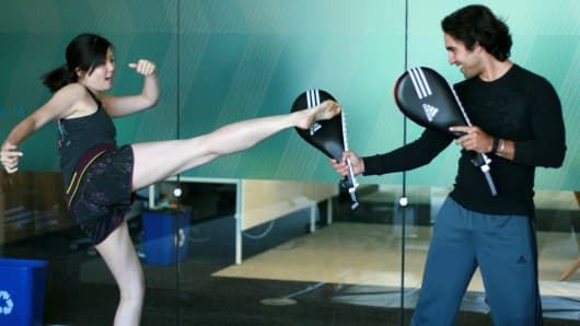 Employees at FitBit take kickboxing classes on campus.