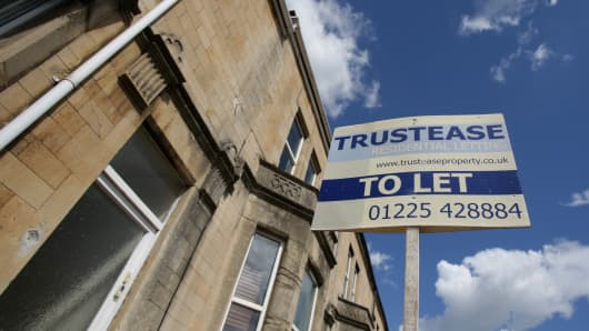 A 'To Let' letting sign is seen displayed outside a rental property in an area that is popular for buy-to-let properties