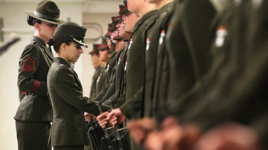 An officer inspects Marine recruits during boot camp on February 26, 2013, at Parris Island, S.C.