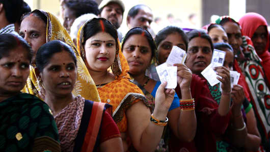 Indian women wait is queue to cast their votes during the last phase of Lok Sabha election on May 12, 2014 in Varanasi, India.