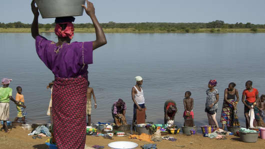 Women washing along the Niger River near Babila, Guinea.