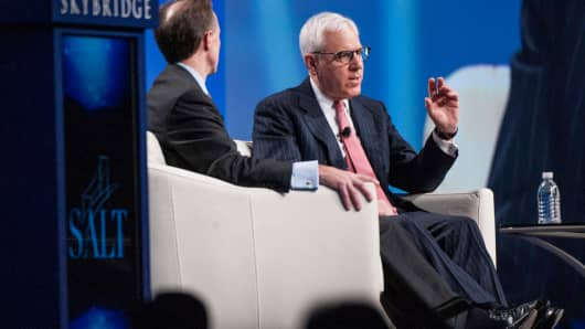 Gregory Fleming, head of Morgan Stanley Wealth Management, left, listens as Carlyle Group's David Rubenstein speaks during the Skybridge Alternatives (SALT) conference in Las Vegas, May 15, 2014.