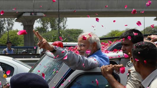 Narendra Modi waves to supporters in New Delhi