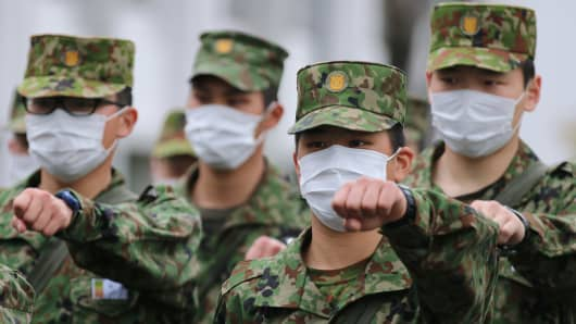 National Defense Academy of Japan (NDA) cadets march to class at the NDA campus in Yokosuka, Kanagawa Prefecture, Japan, on Monday, April 21, 2014.