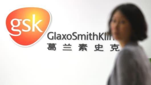 An employee of British drug firm GlaxoSmithKline (GSK) enters their office headquarters in Shanghai.