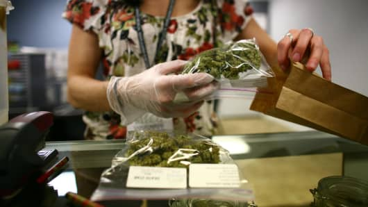 An employee packages a patient's cannabis at a medical cannabis center in Lakewood, Colorado.