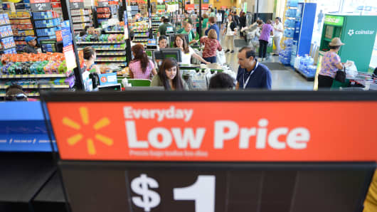 Shoppers pay for their purchases at the cash register at a Walmart Neighborhood Market in Panorama City, California.